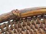 收緣:上藤條以附條打結縫綴
