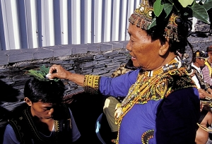 During Paiwan 5-Year festival, the female shaman prays for good fortune for the braves from home
